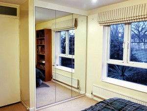 Wardrobe with mirror doors